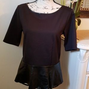 Black top with leather look peplum